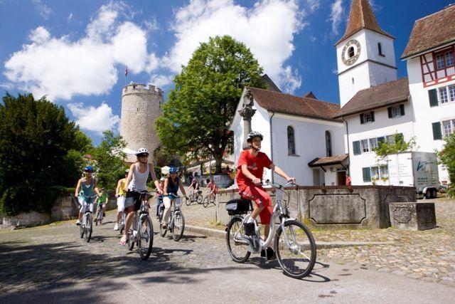 Group biking through Switzerland on electric bikes