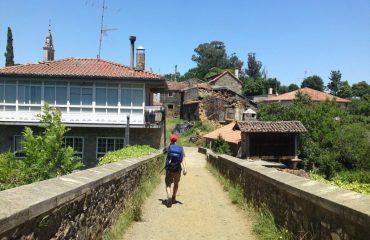 0004fa_spain_galicia_Man-walking-over-bri-g.jpg