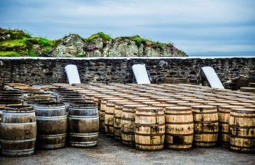 Whisky barrels by the sea