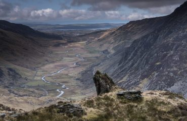 looking_to_anglesey_up_the_nant_ffrancon_valley_from_y_gribin_snowdonia_national_park_north_wales_uk.jpg